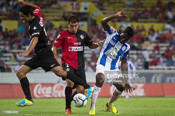 Sergio Amaury Ponce of Atlas struggles for the ball with Duvier Riascos of Pachuca during the Apertura 2013 Liga Bancomer MX at Jalisco Stadium on...
