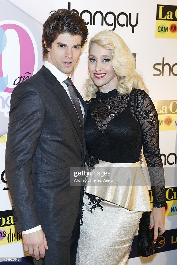 Sergio Arce (L) and singer Geraldine Larrosa of Innocence attends Shangay Magazine 20th Anniversary in Madrid at teatro Nuevo Alcala on December 10, 2013 in Madrid, Spain.
