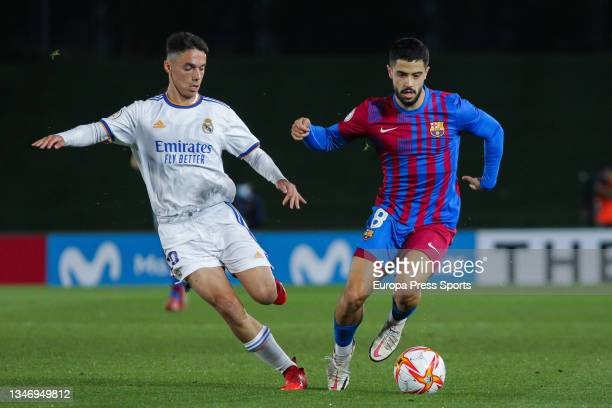 Sergio Arribas of Real Madrid Castilla and Alvaro Sanz of FC Barcelona B in action during Primera RFEF Group 2 football match played between Real...