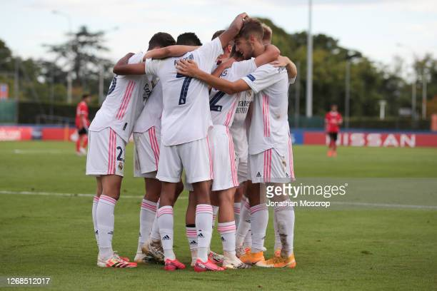Sergio Arribas of Real Madrid celebrates with team mates after his cross was turned into the goal by Henrique Jocu of Benfica to give Real Madrid a...