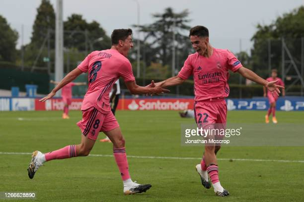 Sergio Arribas of Real Madrid celebrates with teammate Carlos Gonzalez after scoring to level the game at 1-1 during the UEFA Youth League Round of...