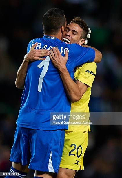 Sergio Asenjo of Villarreal celebrates the goal with his teammate Gabriel during the La Liga match between Elche CF and Villarreal CF at Estadio...