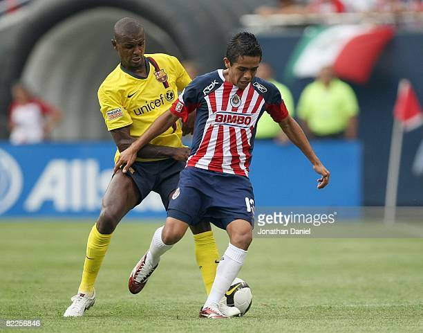 Sergio Avila of CD Guadalajara controls the ball against Eric Abidal of FC Balcelona during a international friendly match on August 3, 2008 at...