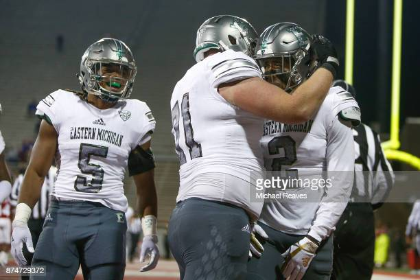 Sergio Bailey II of the Eastern Michigan Eagles celebrates with teammates after a touchdown against the Miami Ohio Redhawks during the second half at...