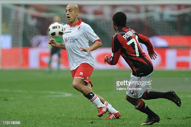 Sergio Bernardo Almiron of AS Bari in action against Robinho of AC Milan during the Serie A match between AC Milan and AS Bari at Stadio Giuseppe...