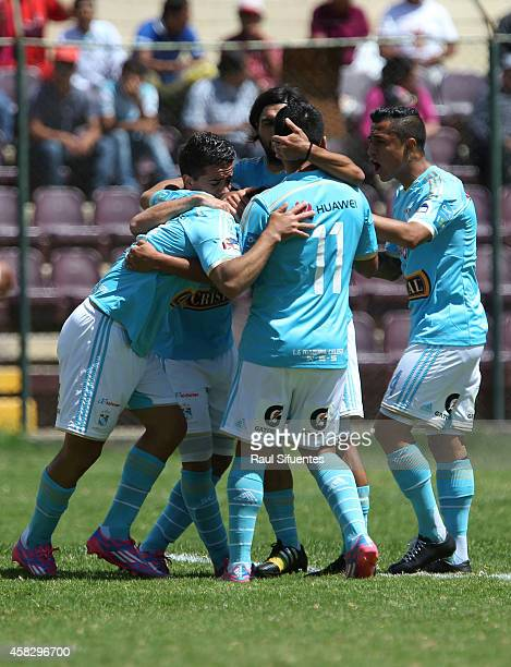 Sergio Blanco of Sporting Cristal celebrates with his teammates after scoring the first goal of his team against Leon de Huanuco during a match...