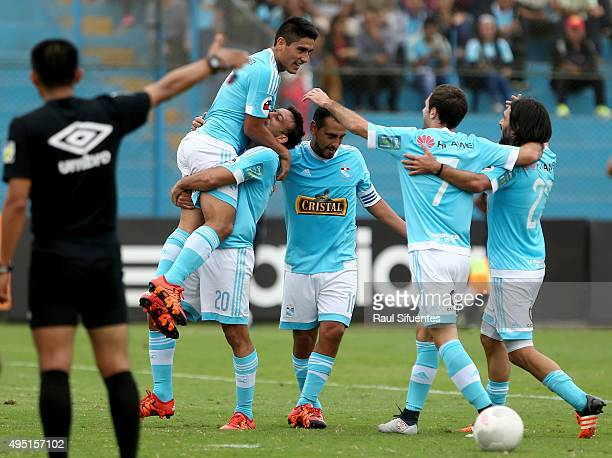 Sergio Blanco of Sporting Cristal celebrates with teammates after scoring the opening goal during a match between Sporting Cristal and Leon de...