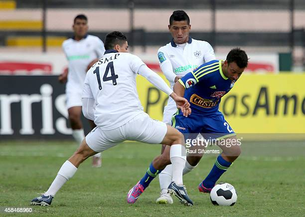 Sergio Blanco of Sporting Cristal struggles for the ball with Luis Alvarez of San Martin during a match between San Martin and Sporting Cristal as...