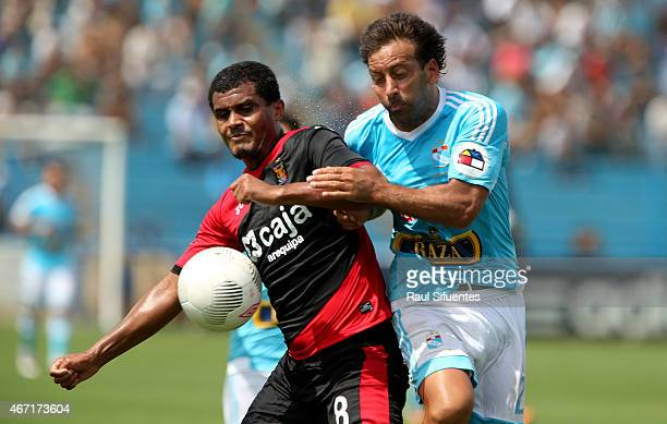 Sergio Blanco of Sporting Cristal struggles for the ball with Nelinho Quina of FBC Melgar during a match between Sporting Cristal and FBC Melgar as...