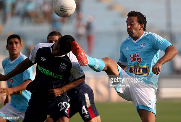 Sergio Blanco of Sporting Cristal struggles for the ball with Wilder Cartagena of San Martin during a match between Sporting Cristal and San Martin...