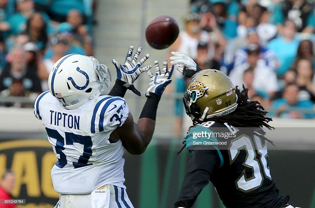 Sergio Brown #38 of the Jacksonville Jaguars attempts to break up a pass intended for Zurlon Tipton #37 of the Indianapolis Colts during the game at EverBank Field on December 13, 2015 in Jacksonville, Florida.
