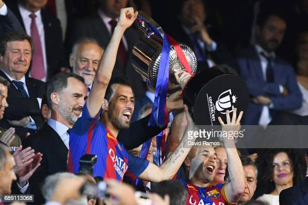 Sergio Busquets and Andres Iniesta of FC Barcelona holds up the trophy after winning the Copa Del Rey Final between FC Barcelona and Deportivo Alaves...