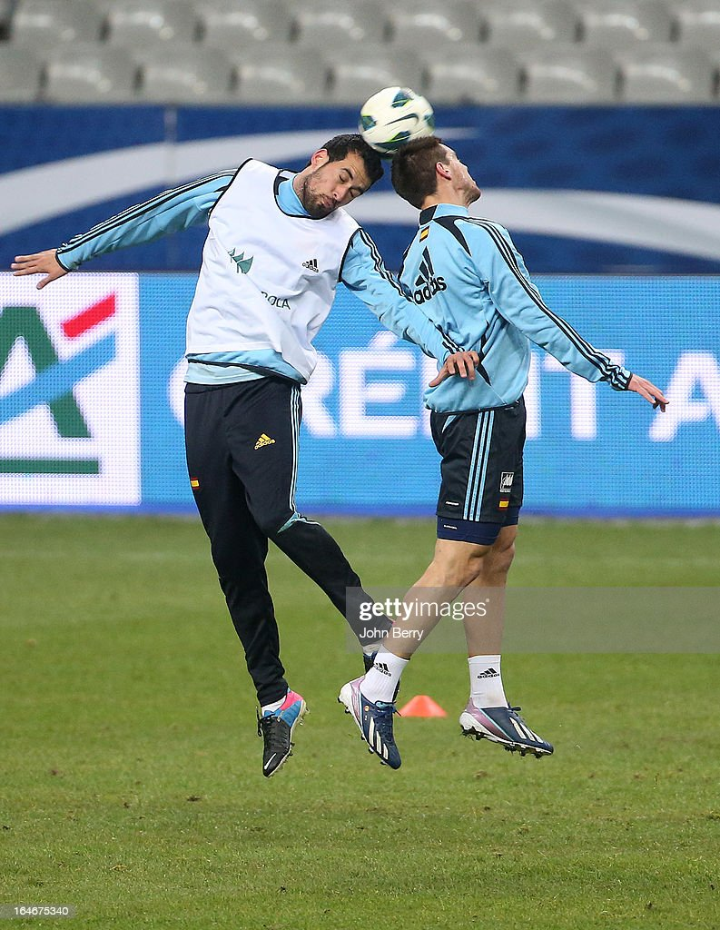 Sergio Busquets and Cesar Azpilicueta of Spain fight for the ball during the practice session the day before the FIFA World Cup 2014 qualifier between France and Spain at the Stade de France on March 25, 2013 in Saint-Denis near Paris, France.