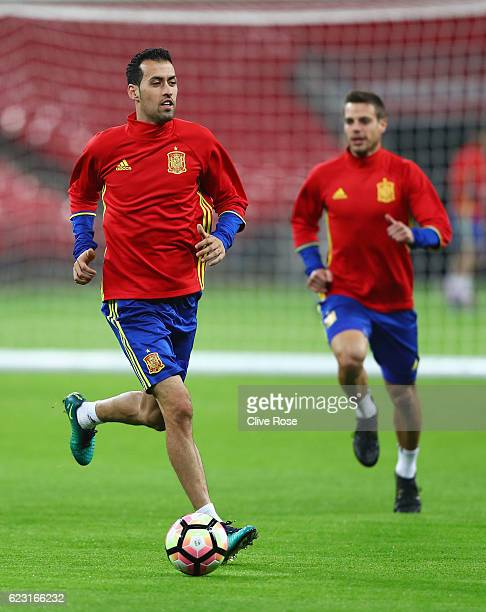 Sergio Busquets and Cesar Azpilicueta of Spain warm up during a training session at Wembley Stadium on November 14 2016 in London England