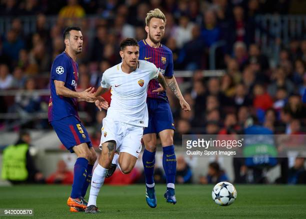 Sergio Busquets and Ivan Rakitic of Barcelona competes for the ball with Lorenzo Pellegrini of Roma during the UEFA Champions League Quarter Final...