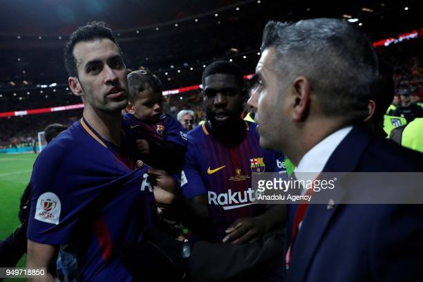Sergio Busquets and Samuel Umtiti talk with security members after Copa del Rey Final soccer match between Sevilla and Barcelona at Wanda...