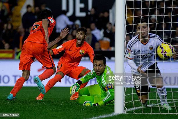 Sergio Busquets Burgos of FC Barcelona celebrates his opening goal with team mate Neymar JR as goalkeeper Diego Alves lies on the ground close to his...