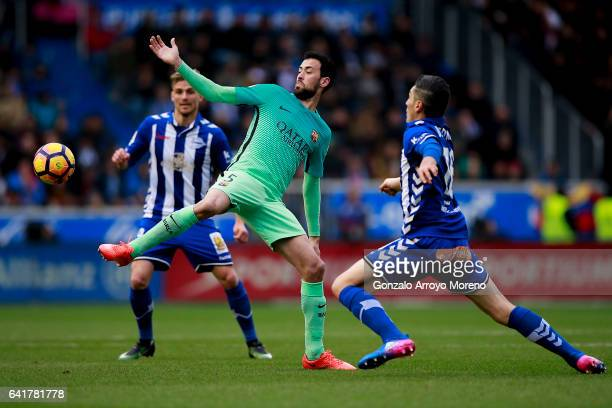 Sergio Busquets Burgos of FC Barcelona competes for the ball with Daniel Torres of Deportivo Alaves and his teammate Christian Santos during the La...