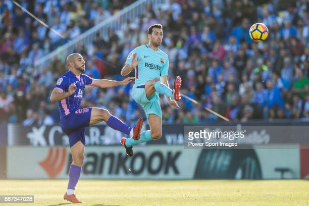 Sergio Busquets Burgos of FC Barcelona fights for the ball with Nourredine Amrabat of CD Leganes during the La Liga 201718 match between CD Leganes...
