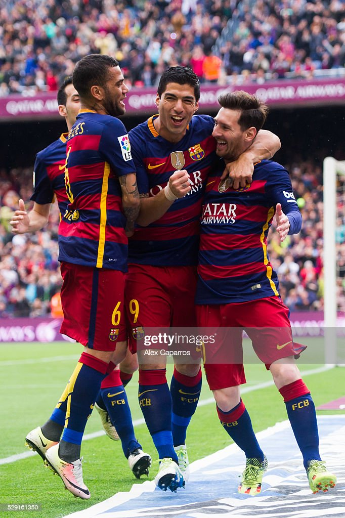 Sergio Busquets, Dani Alves and Luis Suarez celebrate with their teammate Lionel Messi after scoring the opening goal during the La Liga match between FC Barcelona and RCD Espanyol at Camp Nou on May 8, 2016 in Barcelona, Spain.