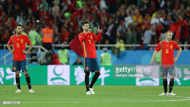Sergio Busquets Gerard Pique and Andres Iniesta of Spain stand dejected during the 2018 FIFA World Cup Russia group B match between Spain and Morocco...