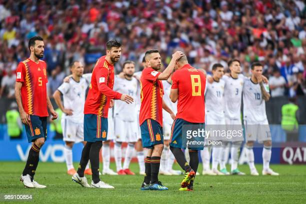 Sergio Busquets Gerard Piquen Jordi Alba and Koke of Spain dejected during the FIFA World Cup Round of 26 match between Spain and Russia at Luzhniki...