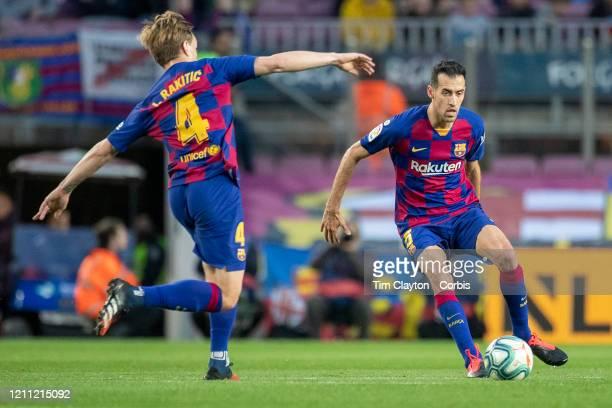 Sergio Busquets of Barcelona and Ivan Rakitic of Barcelona in action during the Barcelona V Real Sociedad La Liga regular season match at Estadio...