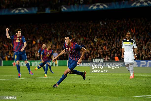 Sergio Busquets of Barcelona celebrates scoring his sides opening goal as Didier Drogba of Chelsea stands dejected during the UEFA Champions League...