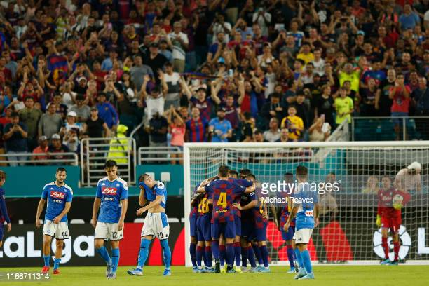 Sergio Busquets of Barcelona celebrates with teammates after scoring the first goal of his team against SSC Napoli during a preseason friendly match...
