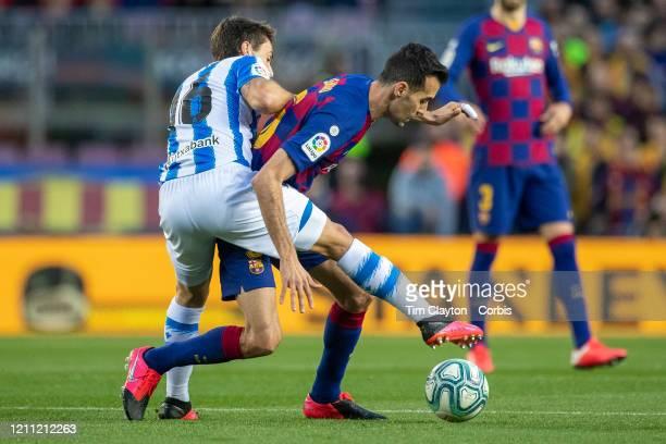 Sergio Busquets of Barcelona challenged by Ander Guevara of Real Sociedad during the Barcelona V Real Sociedad La Liga regular season match at...