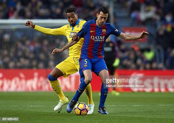 Sergio Busquets of Barcelona competes for the ball with KevinPrince Boateng of Las Palmas during the La Liga match between FC Barcelona and UD Las...