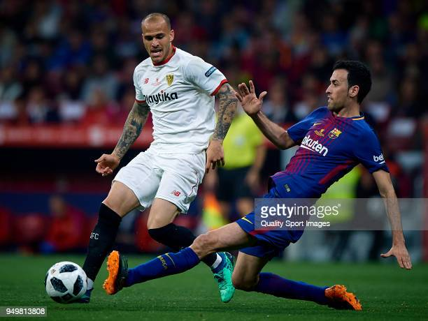 Sergio Busquets of Barcelona competes for the ball with Sandro of Sevilla during the Spanish Copa del Rey Final match between Barcelona and Sevilla...