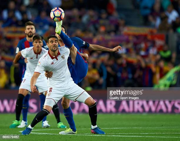 Sergio Busquets of Barcelona competes for the ball with Vicente Iborra of Sevilla during the La Liga match between FC Barcelona and Sevilla FC at...