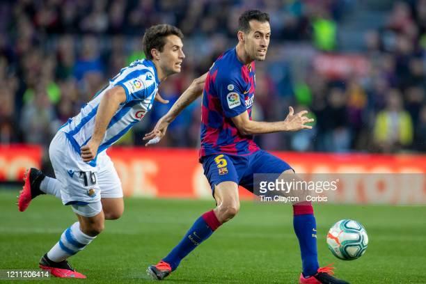 Sergio Busquets of Barcelona defended by Ander Guevara of Real Sociedad during the Barcelona V Real Sociedad La Liga regular season match at Estadio...