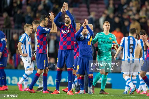 Sergio Busquets of Barcelona Gerard Pique of Barcelona Lionel Messi of Barcelona and MarcAndre ter Stegen of Barcelona salute the fans after the...