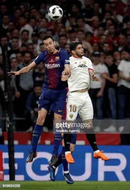 Sergio Busquets of Barcelona in action against Ever Banega of Sevilla during Copa del Rey Final soccer match between Sevilla and Barcelona at Wanda...