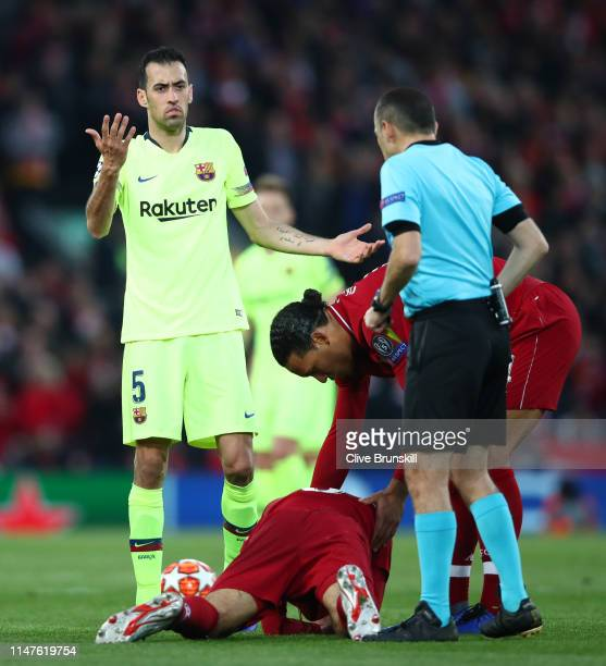 Sergio Busquets of Barcelona reacts as he is booked by referee Cuneyt Cakir after a clash with Fabinho of Liverpool during the UEFA Champions League...
