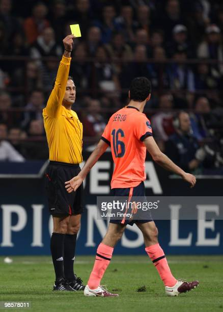 Sergio Busquets of Barcelona receives a yellow card from referee Olegario Benquerenca during the UEFA Champions League Semi Final 1st Leg match...