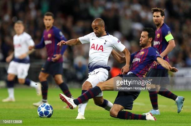 Sergio Busquets of Barcelona tackles Lucas Moura of Tottenham Hotspur during the Group B match of the UEFA Champions League between Tottenham Hotspur...
