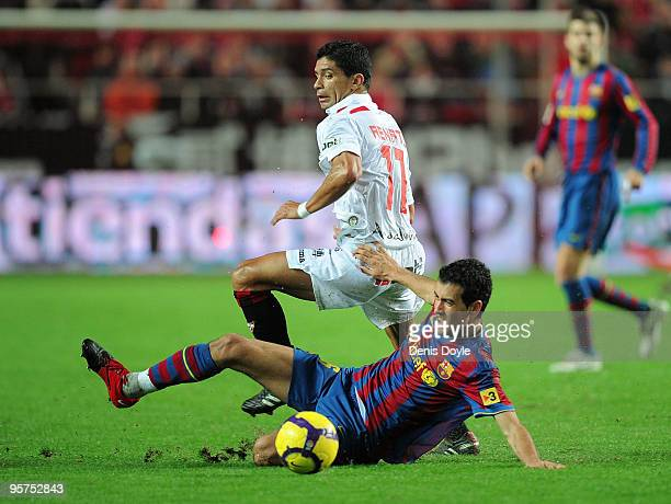 Sergio Busquets of Barcelona tackles Renato Dirnei of Sevilla during the last 16 second leg Copa del Rey match between Barcelona and Sevilla at the...