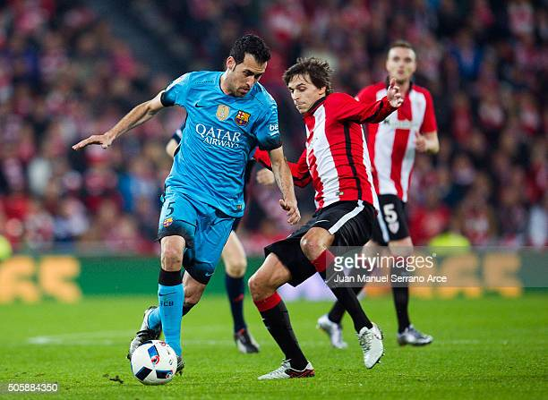 Sergio Busquets of FC Barcelola duels for the ball with Ander Iturraspe of Athletic Club during the Copa del Rey Quarter Final First Leg match...