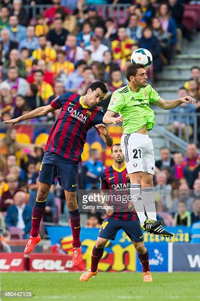 Sergio Busquets of FC Barcelona and Roberto Torres of CA Osasuna fight for the ball during the La Liga match between FC Barcelona and CA Osasuna at...