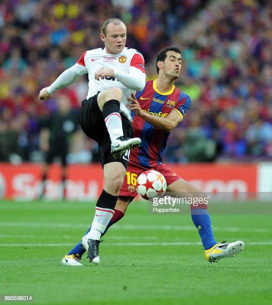 Sergio Busquets of FC Barcelona and Wayne Rooney of Manchester United in action during the UEFA Champions League final between FC Barcelona and...