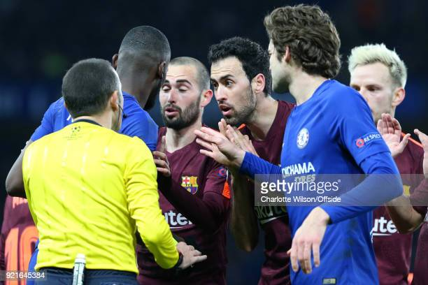 Sergio Busquets of FC Barcelona argues with Referee Cuneyt Cakir that the yellow card against Antonio Rudiger of Chelsea should have been a red...