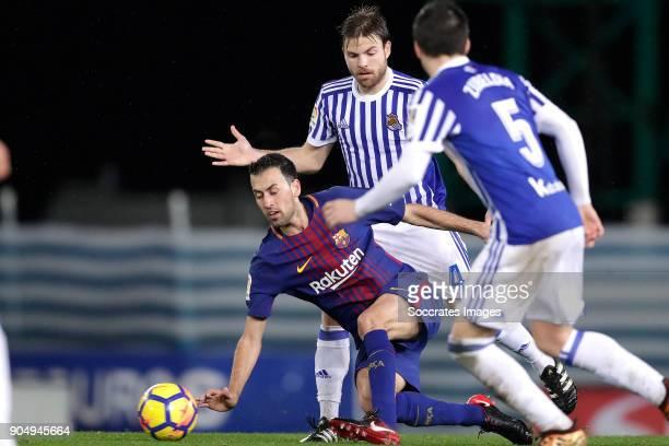 Sergio Busquets of FC Barcelona Asier Illarramendi of Real Sociedad during the La Liga Santander match between Real Sociedad v FC Barcelona at the...