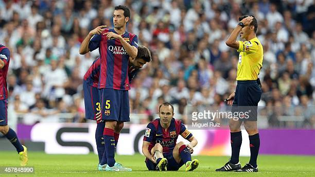 Sergio Busquets of FC Barcelona asks for the substitution of Andres Iniesta during the la Liga match between Real Madrid CF and FC Barcelona at...