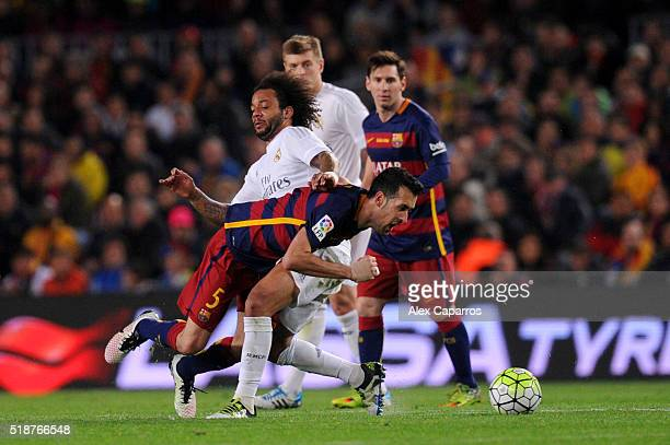 Sergio Busquets of FC Barcelona battles for the ball with Marcelo of Real Madrid CF during the La Liga match between FC Barcelona and Real Madrid CF...