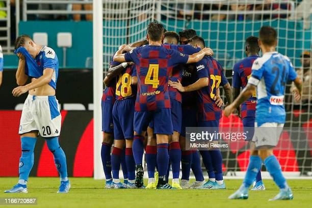 Sergio Busquets of FC Barcelona celebrates with teammates after scoring the first goal of his team against SSC Napoli during a preseason friendly...