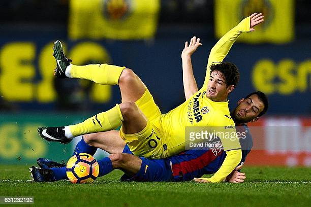 Sergio Busquets of FC Barcelona competes for the ball with Alexandre Pato of Villarreal CF during the La Liga match between Villarreal CF and FC...