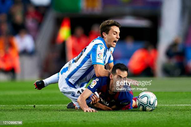 Sergio Busquets of FC Barcelona competes for the ball with Ander Guevara of Real Sociedad during the Liga match between FC Barcelona and Real...